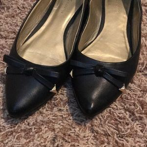 BCBGeneration black wedge flat with gold tip bow